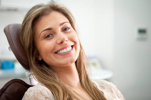 A woman smiling in a dental chair at Nelson R. Diers Orthodontics
