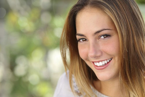 A smiling woman after her orthodontic treatment at Nelson R. Diers Orthodontics